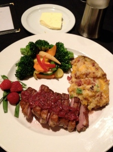 Duck with raspberry sauce and a twice baked potato